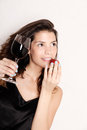 Portrait of a beautiful latin woman eating a strawberry and drinking wine Royalty Free Stock Images