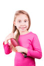 Portrait of a beautiful little girl brushing her long hair isolated on white hair care concept Stock Photo