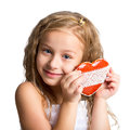 Portrait of a beautiful little girl with gingerbread heart-shaped. Photo a child on a white background Royalty Free Stock Photo