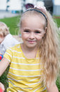 Portrait of beautiful little girl with long hair watching on you Royalty Free Stock Photo
