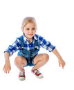 Portrait of a beautiful little girl pretty sitting on his haunches Stock Photography