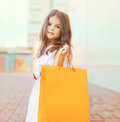Portrait of beautiful little girl with shopping bag Royalty Free Stock Photo