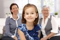 Portrait of beautiful little girl smiling happily mother and granny at background Royalty Free Stock Photography