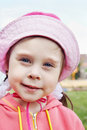 Portrait of a beautiful little girl wears a hat close up Stock Images