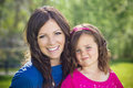 Portrait of a beautiful mother and daughter cute little girl her outdoors Royalty Free Stock Images