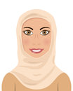 Portrait of a beautiful muslim woman smiling with brown eyes and wearing a hijab isolated on white background Royalty Free Stock Photos