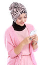 Portrait of beautiful muslim woman texting with her smartphone isolated over white background Royalty Free Stock Photos