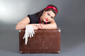 Portrait beautiful pinup girl retro suitcase over grey Stock Image