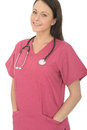 Portrait of a beautiful professional happy relaxed young female doctor with stethoscope gp general practitioner or nurse in her Royalty Free Stock Photography
