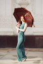 Portrait of beautiful red haired young woman with umbrella Royalty Free Stock Photo