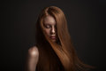 Portrait of beautiful redhair woman with flying ha frecles and hair on dark background Stock Images