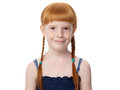 Portrait of a beautiful redhead joyful little girl in a blue dress Royalty Free Stock Photo