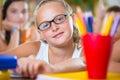 Portrait of beautiful schoolgirl girl studying in classroom at school Stock Image