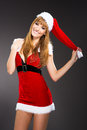 Portrait of beautiful sexy girl wearing santa claus clothes on gray background Royalty Free Stock Images