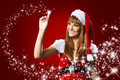 Portrait of beautiful sexy girl wearing santa claus clothes on red background with stars Stock Photos