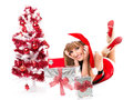 Portrait of beautiful sexy girl wearing santa claus clothes on white background Royalty Free Stock Images