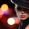 Portrait of the beautiful sexy woman with red lips in modern black hat Royalty Free Stock Images
