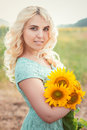 Portrait of a beautiful smiling blonde girl outdoors Royalty Free Stock Photo