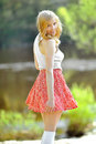 Portrait of a beautiful smiling girl in a skirt outdoors Stock Photos