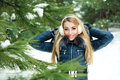 Portrait of beautiful smiling girl in snowy forest Royalty Free Stock Photo