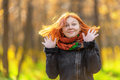 Portrait of beautiful smiling red haired woman in autumn park shallow dof Stock Images
