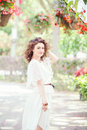 Portrait of beautiful smiling white Caucasian girl woman with long dark red brown hair, in white summer dress Royalty Free Stock Photo