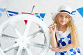 Portrait of a beautiful summer girl elegant young wearing fashion spotted dress and white hat standing next to decorative wooden Royalty Free Stock Image