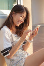 Portrait of beautiful teen woman chat social media on smrt phone with happiness face use for people and modern hi techonology to Royalty Free Stock Images