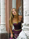 Portrait of beautiful teenage girl in historical dress near old house Stock Photo