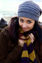 Portrait of beautiful teenager feeling cold in winter happy young woman holding scarf Royalty Free Stock Image