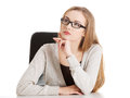 Portrait of beautiful thoughtful woman in eyeglasses sitting. Royalty Free Stock Photo