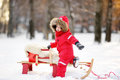 Portrait of beautiful toddler boy having fun in winter park Royalty Free Stock Photo