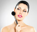 Portrait beautiful woman applying blusher face using cosmetic brush Stock Photos