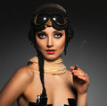 Portrait of a beautiful woman aviator with a glamorous retro mak young makeup Stock Photos