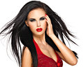 Portrait of the beautiful woman with black hairs and red lips straight evening makeup pretty model posing at studio Royalty Free Stock Image