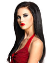Portrait of the beautiful woman with black straight hairs and red lips evening makeup pretty model posing at studio Stock Photos