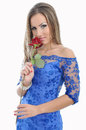 Portrait of a beautiful woman in blue dress and red rose in hand Royalty Free Stock Image