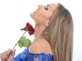 Portrait of a beautiful woman in blue dress and red rose in hand Stock Photo