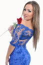 Portrait of a beautiful woman in blue dress and red rose in hand Stock Image