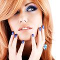 Portrait of a beautiful woman with blue nails blue makeup and long red hairs on white background Stock Photo