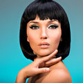 Portrait of beautiful woman with bob hairstyle closeup fashion model face creative makeup Stock Photo