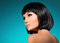 Portrait of beautiful woman with bob hairstyle closeup fashion model face creative makeup Stock Photography