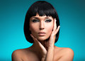 Portrait of beautiful woman with bob hairstyle closeup fashion model face creative makeup Stock Image