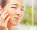 Portrait of beautiful woman concept of skincare young touches face with smooth skin Stock Photography