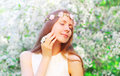 Portrait beautiful woman with floral headband and petals of flowers