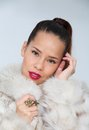 Portrait beautiful woman fur coat Stock Images