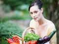 Portrait of a beautiful woman in a garden Royalty Free Stock Image