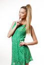 Portrait beautiful woman green dress making hush gesture not isolated white background Royalty Free Stock Photo