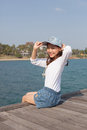 Portrait of beautiful woman happy face sitting on wood port sea side use for people activities holiday vacation beach Royalty Free Stock Images