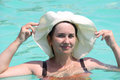 Portrait of a beautiful woman in a hat middle aged swimming pool Royalty Free Stock Photos